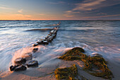 Washing gold, sea shore at dusk, Rugen Island, Mecklenburg Western Pommerania, Germany