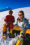 A couple having a rest after snowshoeing, Serfaus, Tyrol, Austria