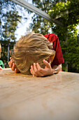 Boy's head in a dish with water, children's birthday party