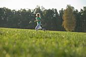 Girl running over meadow
