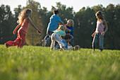 Children playing on grass, children's birthday party