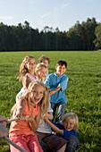 Children playing tug-of-war, children's birthday party