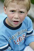 Young boy looking angry, Portrait