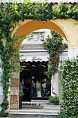 View through a gateway to a shop, Gardone, Lago di Garda, Italia