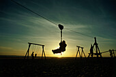 Children playing on playground at weat beach, island Norderney, East Friesland, Lower Saxony, Germany