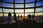 Tourists visiting glass dome, Reichstag building, Berlin, Germany