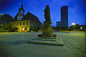 View over market square with John Frederick I monument, city hall and JenTower in background at night, Jena, Thuringia, Germany