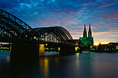 Cologne Cathedral and Hohenzollern Bridge in the eveing, Cologne, North Rhine-Westphalia, Germany