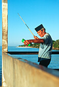 old fisherman on landing stage, lombok, gili trawangan, indonesia