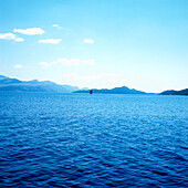 View over Stonski canal with sailboat to peninsula Peljesac, Dalmatia, Croatia