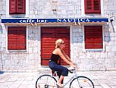 woman going by bike hvar, croatia, dalmatia, adriatic sea