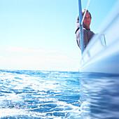 Man on sailboat, Bay of Kiel between Germany and Denmark