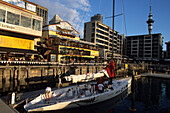 NZL-40 Yacht and Restaurants at Viaduct Basin, Auckland, North Island, New Zealand
