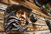 Woodcarving of a man on mountain hut, Krimmler Ache Valley, Hohe Tauern National Park, Austria
