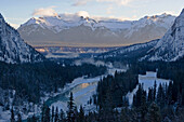 A river flows through a  winter mountain landscape Banff. It is the view out of the Banff Fairmont Springs Hotel auf das Bow River Valley. Banff, Alberta, Rocky Mountains, Alberta, Canada, North America.