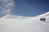A group of people on a skitour to the top of Malka Todorka and Todorin Vrah, Pirin Mountains, Bulgaria, Europe