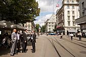 Group of businessmen passing Bahnhofstrasse (most expensive real estate prices in the world), Zurich, Canton Zurich, Switzerland