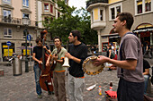 Group of young men making music on the Hirschenplatz, Niederdorfstrasse, Zurich, Canton Zurich, Switzerland