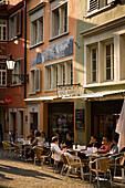 People sitting in a small pavement cafe, Augustinergasse, Zurich, Canton Zurich, Switzerland