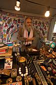 Man (Mike Hamkens) offering indian products on a flea market at Rosenhof, Zurich, Canton Zurich, Switzerland