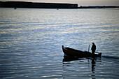 Fisher with Fishing boat, Hiddensee Island, Mecklenburg-Western Pomerania, Germany