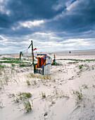 Hooded beach chair on the beach of Norddorf, Amrum Island, Schleswig Holstein, Germany