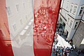 Mozarts birthplace and view of the Getreidegasse with Austrian flag, Salzburg, Austria