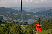 View from the Zwoelferhorn over lake Wolfgangsee with cable car, Salzburg, Austria