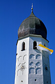 Clock tower of nunnery decorated with flag, island of Fraueninsel, Lake Chiemsee, Chiemgau, Upper Bavaria, Bavaria, Germany