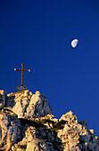 Summit of Kampenwand with cross and moon, Chiemgau range, Chiemgau, Bavarian range, Upper Bavaria, Bavaria, Germany
