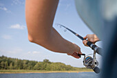 Woman with Fishing Rod, Crown Blue Line Classique Houseboat, Lake Labussee, Mecklenburg Lake District, Mecklenburg Western Pomerania, Germany