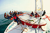 A group of people sailing, Catamaran, Sport