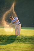 A person playing golf, Sandbunker, Sport
