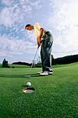 Man playing golf, Paehl, Bavaria, Germany