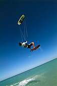 Man kiteboarding, big jump