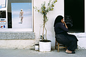 A local woman sitting outside a house in Cyprus