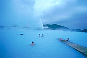 People relaxing in a geothermal spa, Blue Lagoon, Iceland