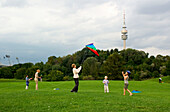 Flying Kites in front of the Olympic Tower, Schwabing, Munich, Bavaria Germany