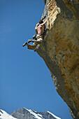 Free climber scaling rock face, Gimmelwald, Lauterbrunnen, Canton Bern, Switzerland