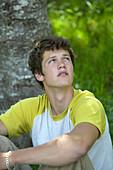 Young man looking up, Gimmelwald, Lauterbrunnen, Canton Bern, Switzerland