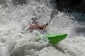 Man kayaking in rapid waters, Lauterbrunnen, Canton Bern, Switzerland