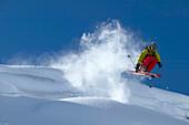 Skier jumping over cornice, Warth, Vorarlberg, Austria