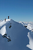 Two skiers on snowy mountains, Valley, St Luc, Chandolin, Valais, Switzerland