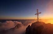 Cross on summit of Dachstein on a foggy morning, Salzburg, Upper Austria, Styria, Austria