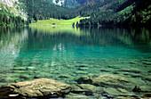 Lake Obersee with alpine pasture of Fischunkelalm, Berchtesgaden Range, Upper Bavaria, Bavaria, Germany