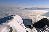 View from summit of Hochstaufen to hut Reichenhaller Haus and Salzkammergut, fog down in Salzburg, Chiemgau range, Chiemgau, Bavarian range, Upper Bavaria, Bavaria, Germany
