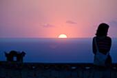 Woman enjoying sunset, Son Marroig, Majorca, Spain