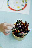 Child choosing a crayon, close-up