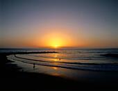 Sunset over beach, Playa de las Americas, Tenerife, Canary Islands, Spain