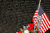 Vietnam Veterans Memorial with wreath and flag, Washington DC, United States, USA